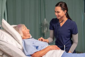 Practical Nurse caring for elderly lady. There's a increasing demand for Practical Nurses in Healthcare facilities.