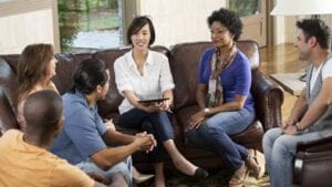 Counselling Therapist group session on a culturally diverse environment.